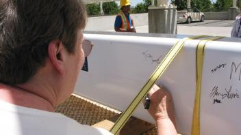Carol Cooper Signs the Beam